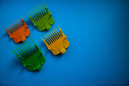 Color shavers isolated on a blue background, perfect to grooming your beard. Flat lay and copyspace