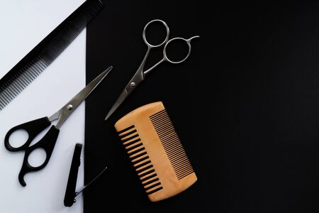 Hair sissors, combs and a razor on black and white background. Copy scape Stock Photo