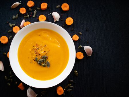 Healthy vegetable cream made with autumn products like squash, carrots and garlic