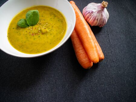 Detox courgette soup on gray background. Close up view.