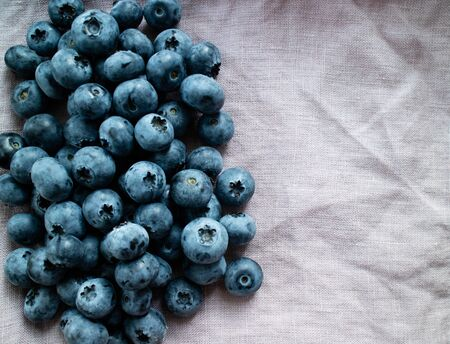 Blueberry isolated on a purple cloth. Top view picture Stock Photo
