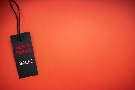 Black Friday sale label on red background. Copy space