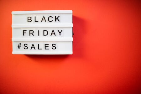 Black Friday Sales on a light box and red background Stock Photo