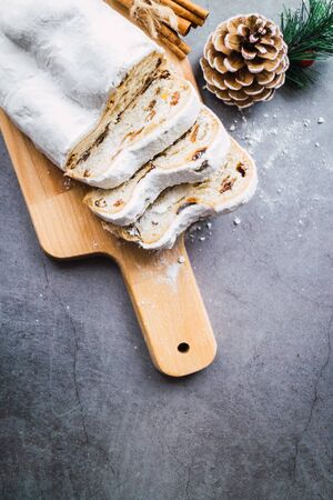 Stollen slices on a table. Blogging concept. Christmas bread traditional from Germany. Vertical picture