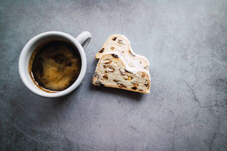 Stollen slices and cup of coffee on concrete background. Top view Archivio Fotografico - 138043267