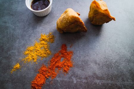 Free meat samosas with potatoes, peas and onion on concrete background. Indian food Top view Stock Photo