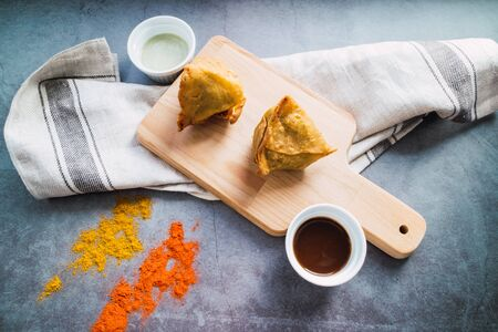 Samosas with potatoes and lamb on concrete background. Indian food Top view