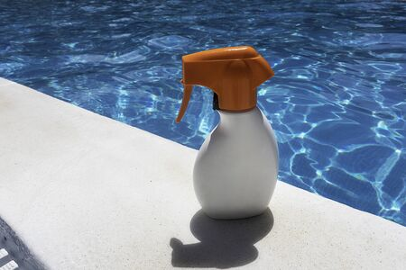 Sunscreen on the pool on a sunny summer day
