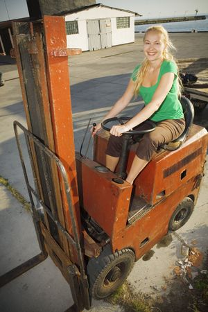jack in a box: forklift with female driver; woman at work Stock Photo