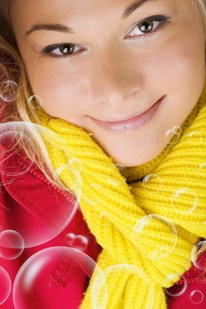 Smiling lady wearing winter scarf - and bubbles