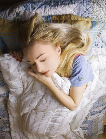 woman lying in bed (sleeping) photo