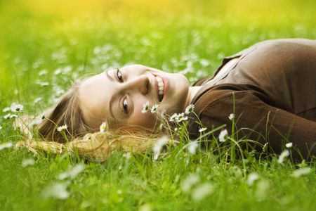 woman lying in grass Stock Photo