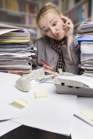 stressed businesswoman at the desk Stock Photo - 5022680