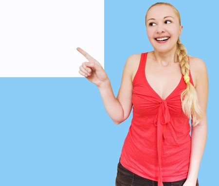 smiling woman pointing towards copyspace Stock Photo - 5247145