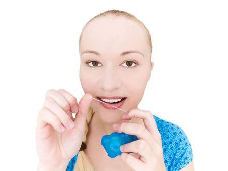 flossing: Woman flossing teeth