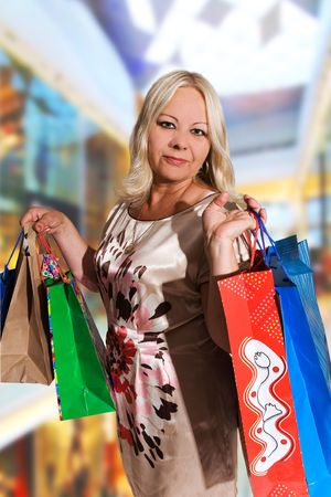 casua: 50 years old woman shopping Stock Photo