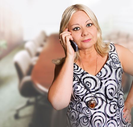 businesswoman in her office using mobile phone photo