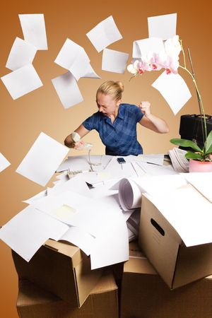 businesswoman in her office and flying paper sheets Stock Photo