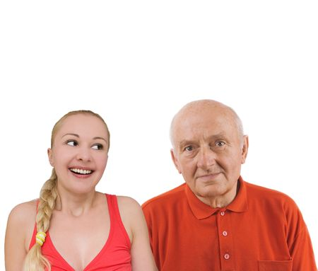 Pretty teen girl spending time with her handsome grandfather photo