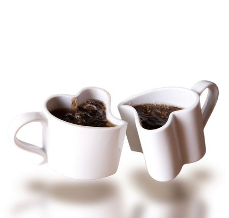 levitating: two heart shaped love cups of coffee levitating