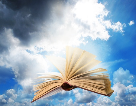 flying opened magic book Stock Photo