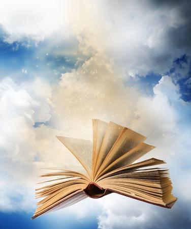 flying opened magic book Stock Photo