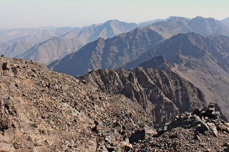 and hiking path: Mountain ridges in Morocco. Trekking on Toubkal - the highest peak.
