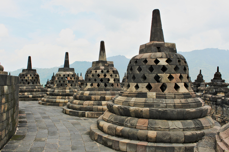 Borobudur - the worlds largest Buddhist temple built in the 9th-century. Mahayana Buddhist temple with many stupa around.