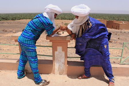 Morocco, Erg Chigaga, July 17, 2011; Two tuaregs in blue dress and white turbans in Morocco Editorial