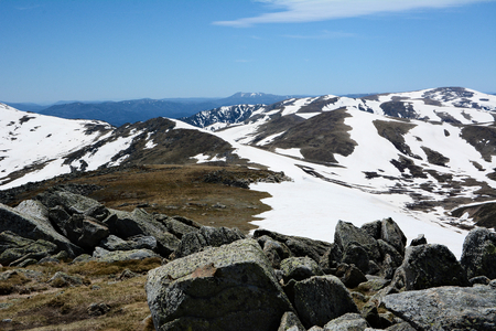 View from the highest peak of Australian mountains - Mount Kosciuszko. Range of Snowy Mountains covered with snow. 版權商用圖片