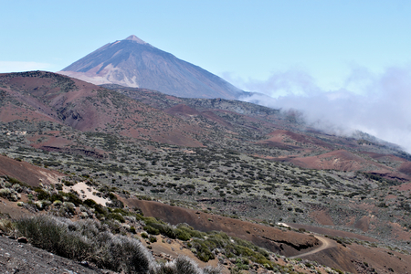 Mount Teide - is a volcano on Tenerife in the Canary Islands. Its 3,718-metre summit is the highest point in Spain and the highest point above sea level in the islands of the Atlantic. Standard-Bild - 117105034