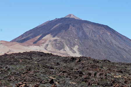 Mount Teide - is a volcano on Tenerife in the Canary Islands. Its 3,718-metre summit is the highest point in Spain and the highest point above sea level in the islands of the Atlantic. Standard-Bild - 117105035