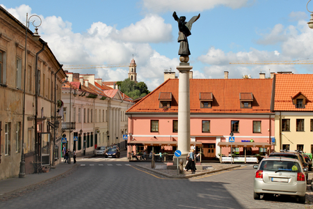 Lithuania, Vilnius; August 14th 2017 - Angel Square in Vilnius in Lithuania with a monument of patron Angel and old buildings around the square. Zarzecze district. Standard-Bild - 123681523