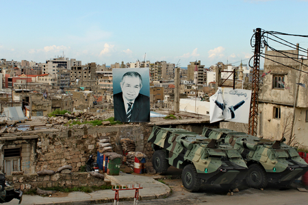 Lebanon, Tripoli; February 13th 2011 - Lebanese city life with posters of politicians and building at the background. Tanks on the street. Standard-Bild - 123681532