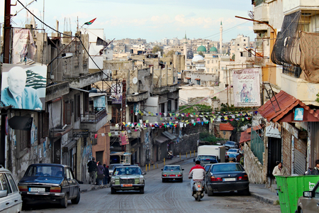Lebanon, Tripoli; February 13th 2011  - Lebanese city life with posters of politicians -Najib Mikati. People walking, car on the street. Standard-Bild - 123681534