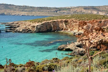 Blue Lagoon, Malta / June 3rd 2019 - Comino Island, with turquoise clear waters and rocky background Standard-Bild - 127499802