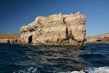 High cilfs with caves on Cominotto Island, near famous Comino Island Standard-Bild - 127499808