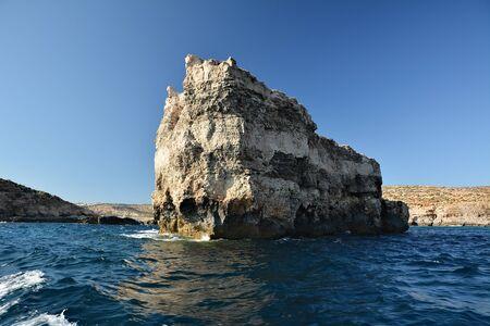 High cilfs with caves on Cominotto Island, near famous Comino Island Standard-Bild - 127499807