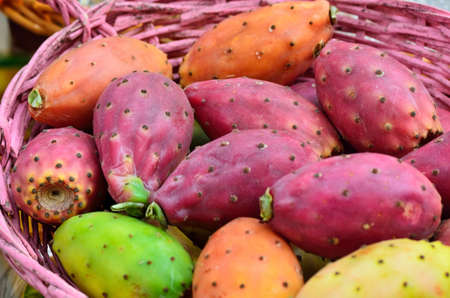 Colored prickly pear in a basket.