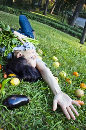 extending: woman with vegetables extending her hand