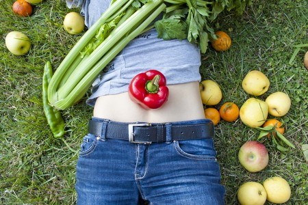 belly pepper: woman with a pepper on her belly Stock Photo
