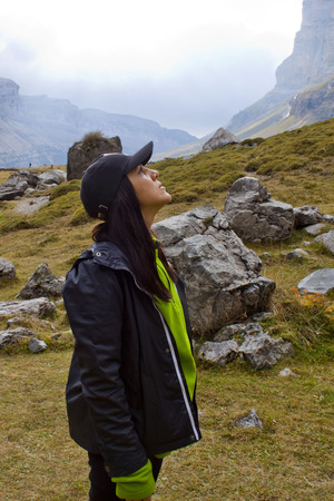 healthful: girl in the mountains looking up
