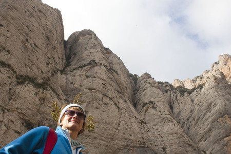 enormous: mountaineer girl hiking in enormous mountain in Huesca, Spain