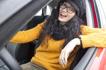 Girl winking her eye in her car Stock Photo