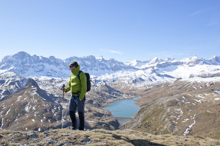 pyrenean: hiker with a Pyrenean lake as background