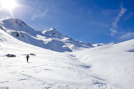 lonesomeness: skier making turns in a sunny day
