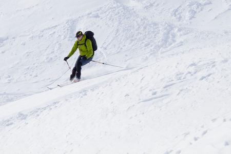 turning: skier speeding while turning Stock Photo