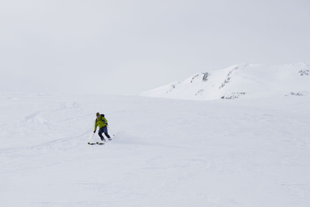turning: skier going fast while turning Stock Photo