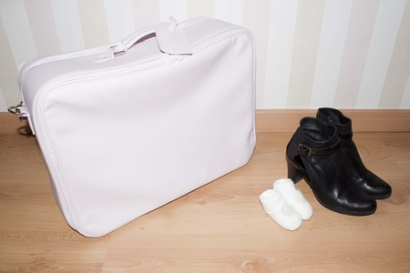 bootees: baby suitcase, bootees and woman shoes