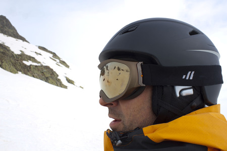touring: skier in a chairlift going up of a mountain